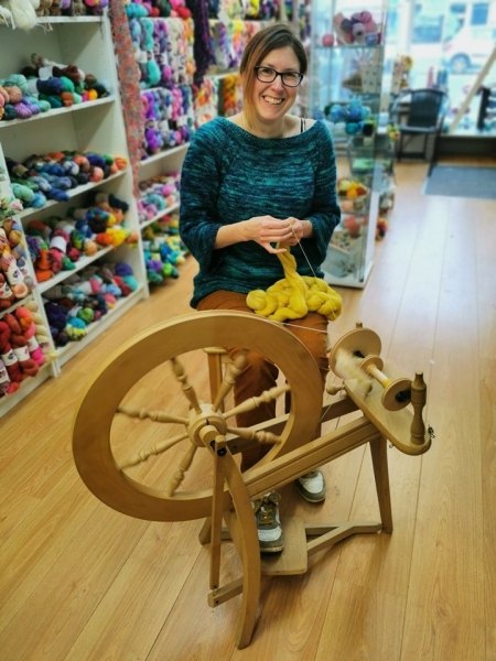 Nikki spinning on her Ashford Traditional wheel at Ewe Felty Thing - photo requirement for the 'Pitch to the Press' challenge